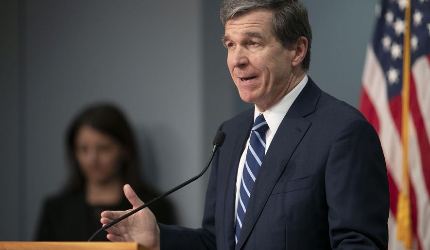 North Carolina Governor Roy Cooper updates the public during a press briefing on the coronavirus pandemic at the Emergency Operations Center, Thursday, May 14, 2020, in Raleigh, N.C. (Robert Willett/The News & Observer via AP)