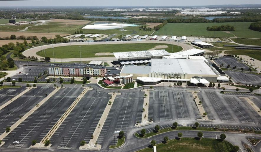 This aerial photo taken Wednesday, May 13, 2020, shows the empty parking lots at Eldorado Scioto Downs in Columbus, Ohio. The casino is tweaking their reopening plans for after the coronavirus lockdown. (Doral Chenoweth/The Columbus Dispatch via AP)