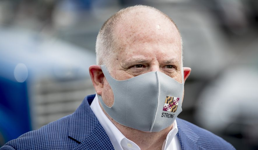 Maryland Gov. Larry Hogan wears a mask with the Maryland state flag on it following a tour of Coastal Sunbelt Produce, Friday, May 15, 2020, in Laurel, Md. (AP Photo/Andrew Harnik) ** FILE **