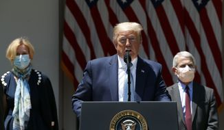 President Donald Trump speaks about the coronavirus in the Rose Garden of the White House, Friday, May 15, 2020, in Washington. Dr. Anthony Fauci, director of the National Institute of Allergy and Infectious Diseases, right, and White House coronavirus response coordinator Dr. Deborah Birx listen. (AP Photo/Alex Brandon)