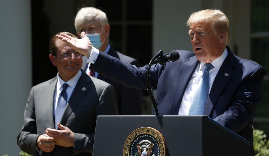 President Donald Trump speaks about the coronavirus in the Rose Garden of the White House, Friday, May 15, 2020, in Washington. Department of Health and Human Services Secretary Alex Azar, left, and Dr. Robert Redfield, director of the Centers for Disease Control and Prevention listen. (AP Photo/Alex Brandon)