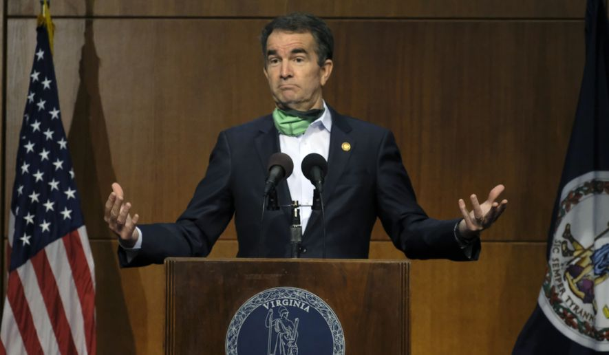 Virginia Gov. Ralph Northam gestures as he answers a reporter's question during his COVID-19 press briefing inside the Patrick Henry Building in Richmond, Va., Friday, May 15, 2020. (Bob Brown/Richmond Times-Dispatch via AP) ** FILE **