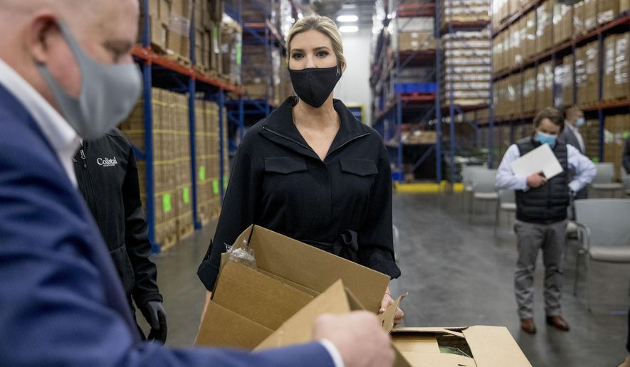 Maryland Gov. Larry Hogan, left, and Ivanka Trump, the daughter of President Donald Trump, center, look through boxes of produce as they tour Coastal Sunbelt Produce, Friday, May 15, 2020, in Laurel, Md. (AP Photo/Andrew Harnik)