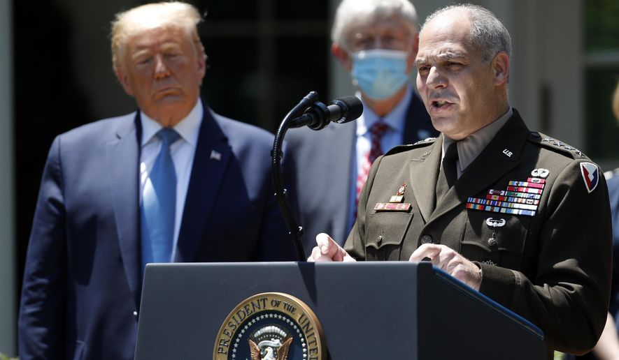 President Donald Trump listens as Gen. Gustave Perna speaks about the coronavirus in the Rose Garden of the White House, Friday, May 15, 2020, in Washington. (AP Photo/Alex Brandon)