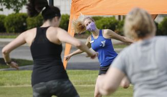 Zumba Gold instructor, Stacey Zebrowski, center, leads a class at the Shady Grove YMCA Friday May 15, 2020, in Glen Allen, Gov. Ralph Northam instituted a phase one reopening of certain portions of the state Friday. (AP Photo/Steve Helber)