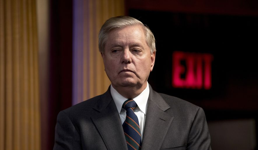 In this March 25, 2020, photo Sen. Lindsey Graham, R-S.C., listens during a news conference about the coronavirus relief bill on Capitol Hill in Washington. (AP Photo/Andrew Harnik) **FILE**