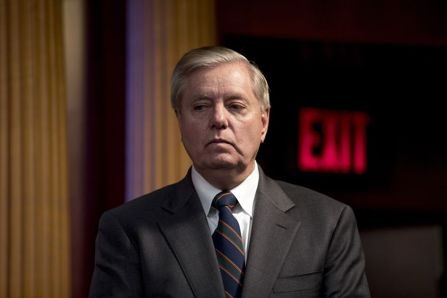 In this March 25, 2020, photo Sen. Lindsey Graham, R-S.C., listens during a news conference about the coronavirus relief bill on Capitol Hill in Washington. (AP Photo/Andrew Harnik) ** FILE **