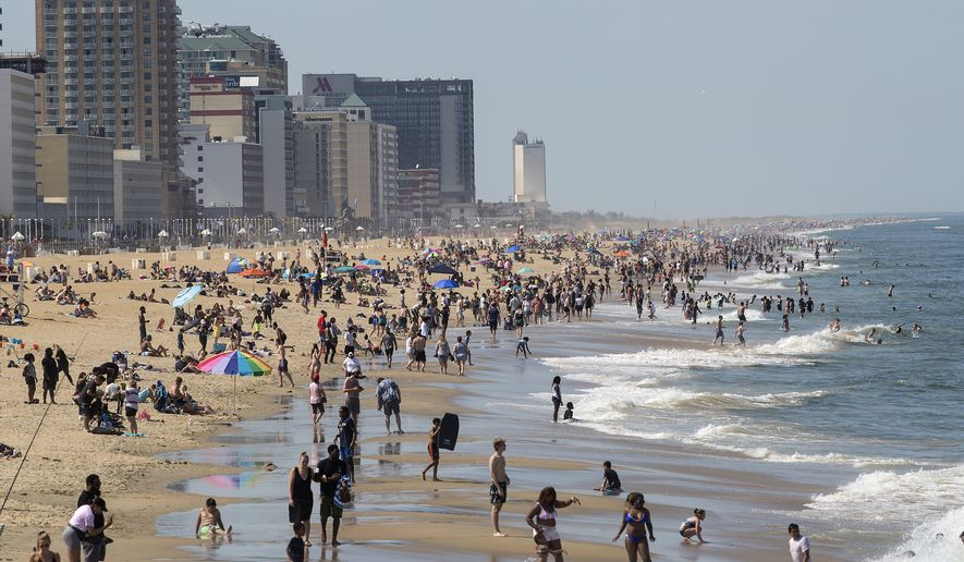 Warm weather draws crowds to the oceanfront, Saturday, May 16, 2020, in Virginia Beach, Va. (Kaitlin McKeown/The Daily Press via AP)