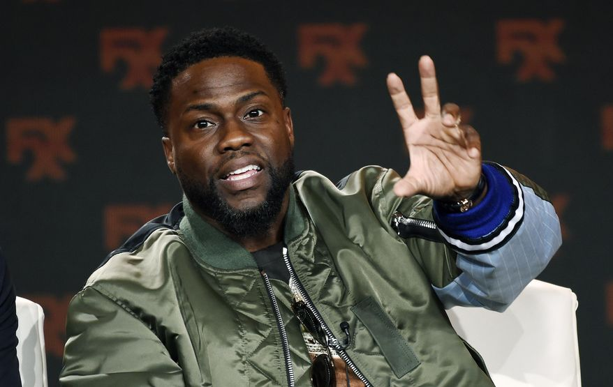 FILE - In this Jan. 9, 2020 file photo shows Kevin Hart during an interview in Pasadena, Calif.  Hart offered a walk-on role in a future film to a health-care worker in the COVID-19 fight. New Jersey anesthesiologist Henry Law, was randomly selected as the winner in an All In Challenge contest. The challenge raises money for organizations that are feeding the hungry during the coronavirus pandemic. (AP Photo/Chris Pizzello, File)