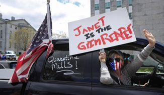 Protesters rally against the executive orders by Maine Gov. Janet Mills to keep some of Maine businesses closed to help prevent the spread of coronavirus, Saturday, May 16, 2020, in Augusta, Maine. (AP Photo/Robert F. Bukaty)