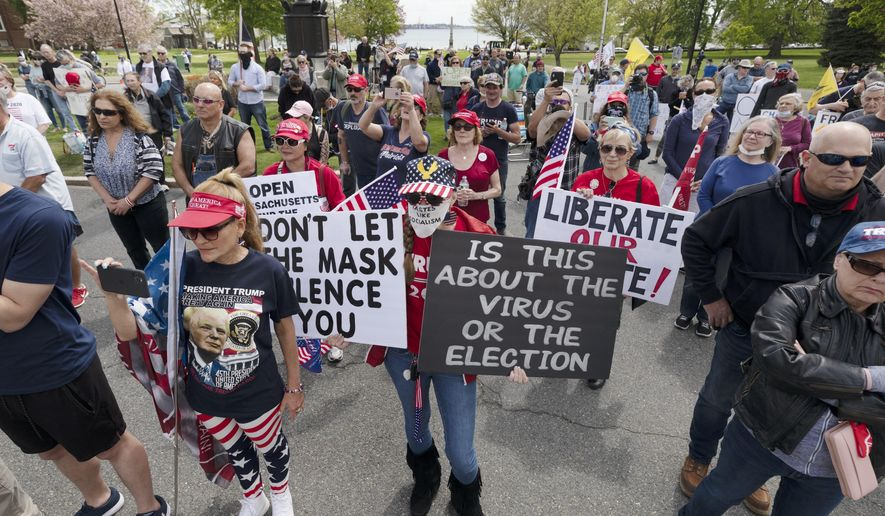 People demonstrate against state restrictions imposed over concern about COVID-19 near the residence of Gov. Charlie Baker, Saturday, May 16, 2020, in Swampscott, Mass. (AP Photo/Michael Dwyer)