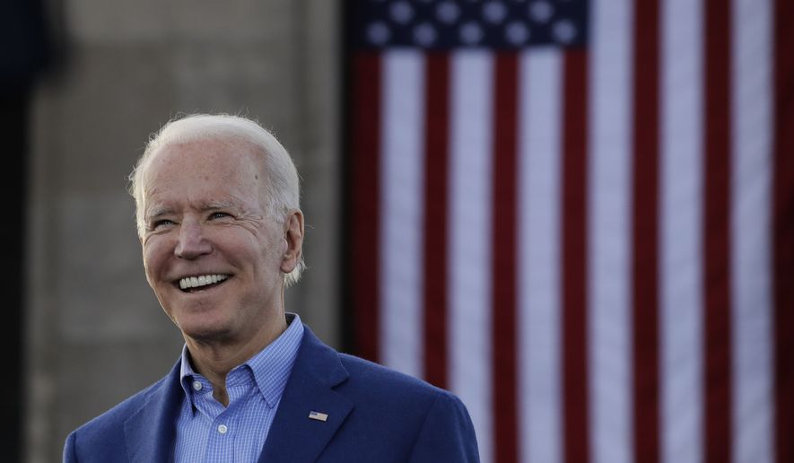 In this March 7, 2020, file photo Democratic presidential candidate former Vice President Joe Biden acknowledges the crowd during a campaign rally in Kansas City, Mo. (AP Photo/Charlie Riedel, File)