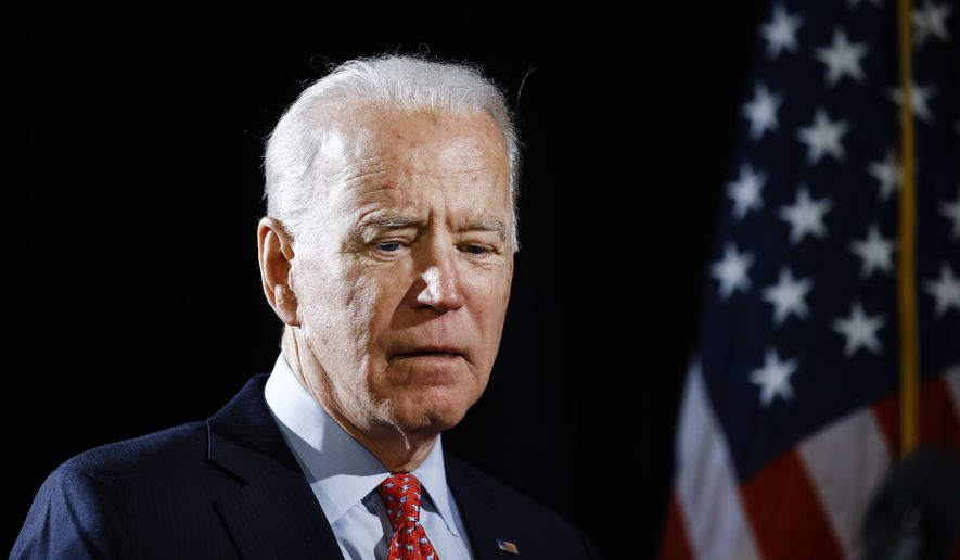 In this March 12, 2020, file photo Democratic presidential candidate former Vice President Joe Biden arrives to speak about the coronavirus in Wilmington, Del. Biden says he would like to be a transition from President Donald Trump to younger, rising Democratic stars. (AP Photo/Matt Rourke, File)