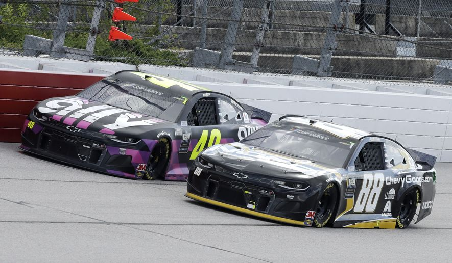 Jimmie Johnson (48) and Alex Bowman (88) come down a straightaway during the NASCAR Cup Series auto race Sunday, May 17, 2020, in Darlington, S.C. (AP Photo/Brynn Anderson) ** FILE **