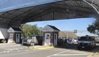 This  Jan. 29, 2016 file photo shows the entrance to the Naval Air Base Station in Pensacola, Fla. On Nov. 20, 2020, the Navy released a report finding that mass shooter Saudi 2nd Lt. Mohammed Saeed Al-shamrani, who had been undergoing flight training at the time, was self-radicalized and motivated by an extreme Islamist ideology. (AP Photo/Melissa Nelson, File)  **FILE**