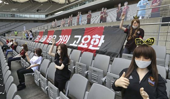 """In this May 17, 2020, photo, cheering mannequins are installed at the empty spectators' seats before the start of a soccer match between FC Seoul and Gwangju FC at the Seoul World Cup Stadium in Seoul, South Korea. A South Korean professional soccer club has apologized after being accused of putting sex dolls in empty stands during a match Sunday in Seoul. In a statement, FC Seoul expressed """"sincere remorse"""" over the controversy, but insisted that it used mannequins, not sex dolls, to mimic a home crowd during its 1-0 win over Gwangju FC at the Seoul World Cup stadium. (Ryu Young-suk/Yonhap via AP) ** FILE **"""
