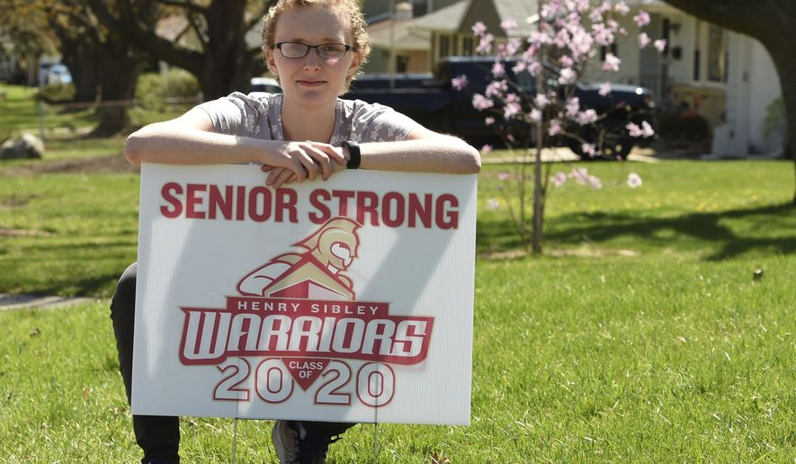 Amanda Lynch, photographed in West St. Paul, Minn. on April 30, 2020, missed most of her senior year at Henry Sibley High School in Mendota Heights after developing meningitis from listeria, a foodborne bacterial illness, and from that, a rare complication called low-pressure hydrocephalus. Lynch's senior year was challenging even before the pandemic, spent mostly in a blur of surgeries, hospitalizations and prayers. (Scott Takushi/Pioneer Press via AP)
