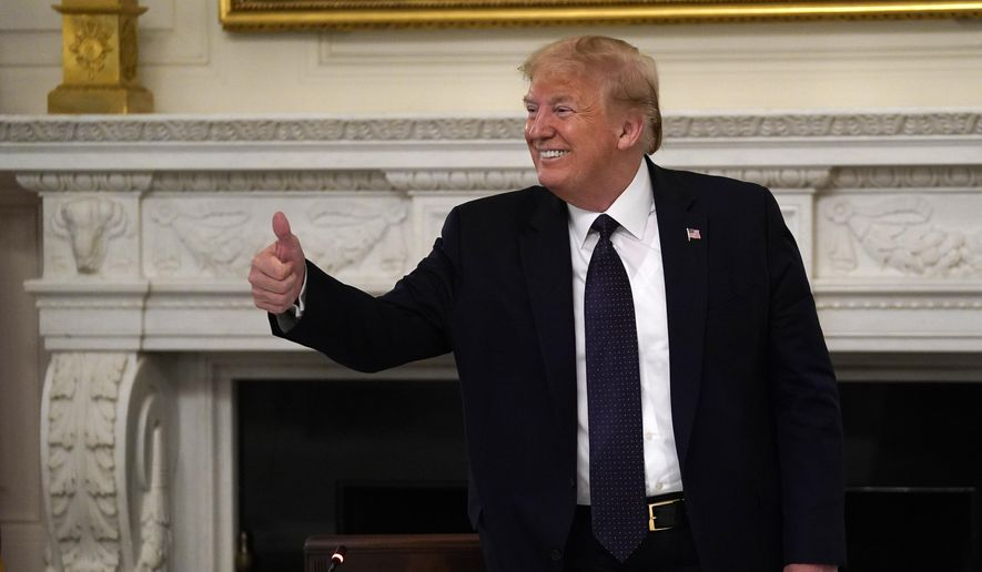 President Donald Trump gestures as he leaves a meeting with restaurant industry executives about the coronavirus response, in the State Dining Room of the White House, Monday, May 18, 2020, in Washington. (AP Photo/Evan Vucci)