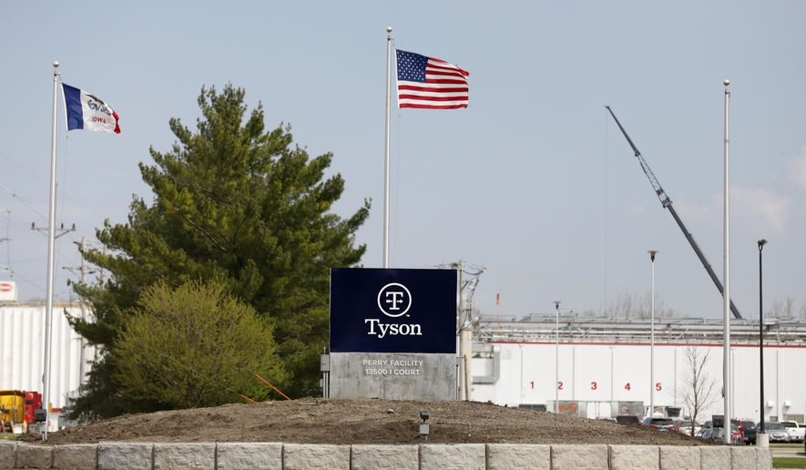The Tyson Foods pork plant is seen, Wednesday, April 22, 2020, in Perry, Iowa. Daily reports of giant meat processing plants closing because workers have tested positive for the coronavirus raise the question of whether the slaughterhouses can remain virus free. (AP Photo/Charlie Neibergall)