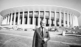 Multi-millionaire Jack Kent Cooke, poses outside The Forum in Inglewood, Calif., the sports palace he's building as the home base of his Los Angeles Lakers and Los Angeles Kings, Nov. 7, 1967. Dedication of the $16 million edifice is set for Dec. 30. (AP Photo/Harold Filan)  **FILE**