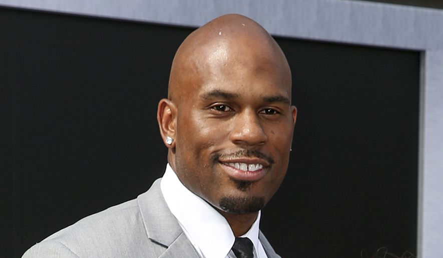"""In this June 28, 2015, file photo, WWE wrestler Shad Gaspard arriving at the Los Angeles premiere of """"Terminator Genisys"""" at the Dolby Theatre in Los Angeles. The former World Wrestling Entertainment pro remained missing Tuesday, May 19, 2020 after being swept out to sea while swimming with his young son over the weekend off Southern California, police said. Gaspard's 10-year-old son Aryeh was rescued and several other swimmers made it out of the water safely after they were caught in a rip current Sunday afternoon at Venice Beach in Los Angeles. (Photo by Rich Fury/Invision/AP, File)"""