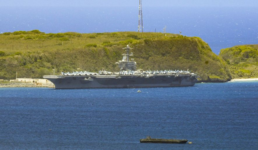 In this April 3, 2020, file photo, the USS Theodore Roosevelt, a Nimitz-class nuclear powered aircraft carrier, is docked along Kilo Wharf of Naval Base Guam. The USS Theodore Roosevelt will return to sea later this week, the ship's captain said Monday night, May 18, nearly two months after the aircraft carrier pulled into Guam with a rapidly growing outbreak of the coronavirus. (Rick Cruz/The Pacific Daily via AP, File) **FILE**