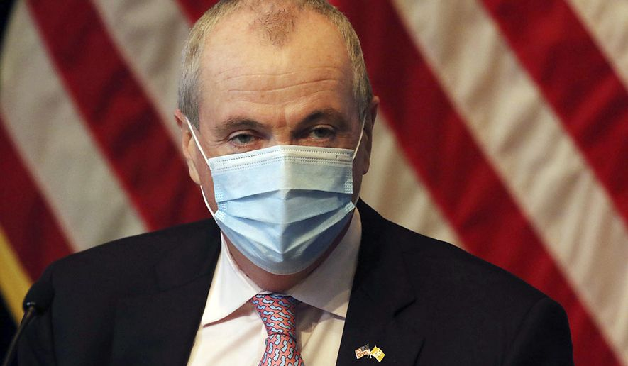 New Jersey Gov. Phil Murphy wears a mask during his daily coronavirus news conference at the War Memorial, Tuesday, May 19, 2020, in Trenton, N.J. (Chris Pedota/The Record via AP, Pool)