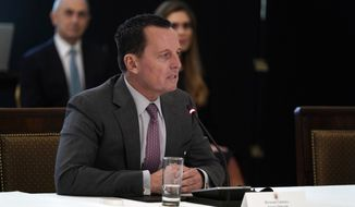 Acting director of national intelligence Richard Grenell speaks during a Cabinet Meeting with President Donald Trump in the East Room of the White House, Tuesday, May 19, 2020, in Washington. (AP Photo/Evan Vucci)