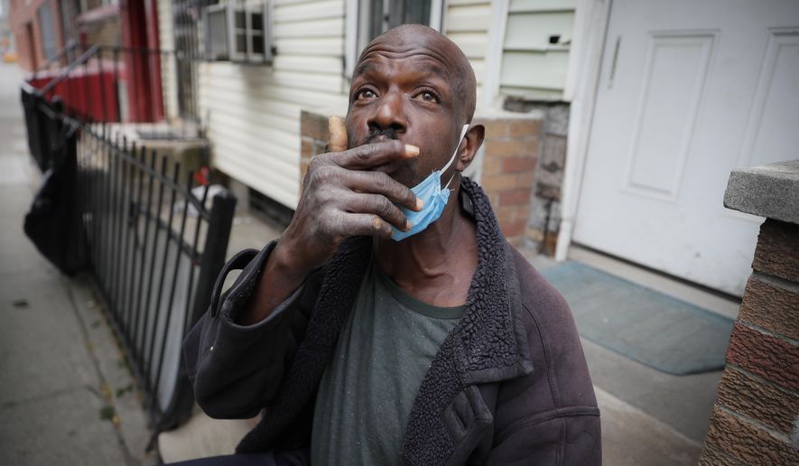Aubrey, 57, describes the loneliness brought on by social distancing protocols after receiving a dose of antipsychotic medication to treat his schizophrenia, Wednesday, May 6, 2020, in the Brooklyn borough of New York. Even before the pandemic, access to mental health services in the U.S. could be difficult, including for people with insurance. Now experts fear COVID-19 will make the situation worse. (AP Photo/John Minchillo)