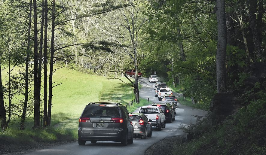 Visitors to Cades Cove make their way around the 11-mile loop Saturday, May 9, 2020 on the first day of the Great Smoky Mountains National Park reopening.(Scott Keller/The Daily Times via AP)