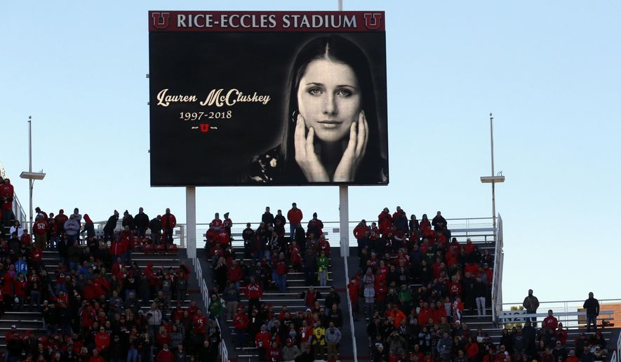 FILE - In this Nov. 10, 2018, file photo, a photograph of University of Utah student and track athlete Lauren McCluskey, who was fatally shot on campus, is projected on the video board before the start of an NCAA college football game between Oregon and Utah in Salt Lake City. The parents of a University of Utah student killed on campus by an ex-boyfriend said Monday they feel a fresh sense of betrayal after new allegations surfaced that a police officer investigating her report kept explicit photos that were intended as evidence. (AP Photo/Rick Bowmer, File)