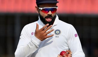The International Cricket Council has recommended that the method of spit polishing the ball should be prohibited during the coronavirus outbreak. (ASSOCIATED PRESS)