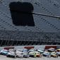 Cars approach the starting line in front of empty stands to start the NASCAR Cup Series auto race Sunday, May 17, 2020, in Darlington, S.C. (AP Photo/Brynn Anderson)  **FILE**