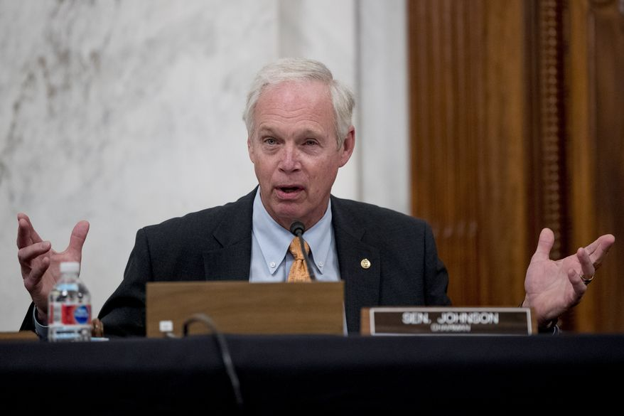 Chairman Sen. Ron Johnson, R-Wis., speaks as the Senate Homeland Security and Governmental Affairs Committee meets on Capitol Hill in Washington, Wednesday, May 20, 2020, to issue a subpoena Blue Star Strategies. (AP Photo/Andrew Harnik) ** FILE **