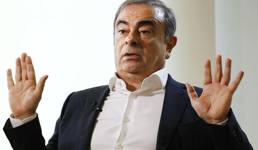 In this Jan. 10, 2020, file photo, former Nissan Chairman Carlos Ghosn speaks to Japanese media during an interview in Beirut, Lebanon. U.S. authorities have arrested two men accused of helping former Nissan Chairman Carlos Ghosn flee Japan while awaiting trial on charges of financial misconduct. Michael Taylor and his son Peter Taylor were arrested Wednesday by the U.S. Marshals Service on Wednesday morning in Harvard, Massachusetts.  (Meika Fujio/Kyodo News via AP, File) **FILE**