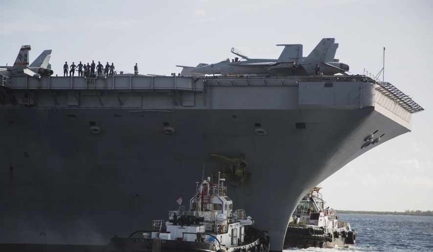 In this photo provided by the U.S. Marine Corps, the aircraft carrier USS Theodore Roosevelt (CVN 71) departs Apra Harbor at Naval Base Guam on Thursday, May 21, 2020,. (Staff Sgt. Jordan E. Gilbert/U.S. Marine Corps via AP)  **FILE**