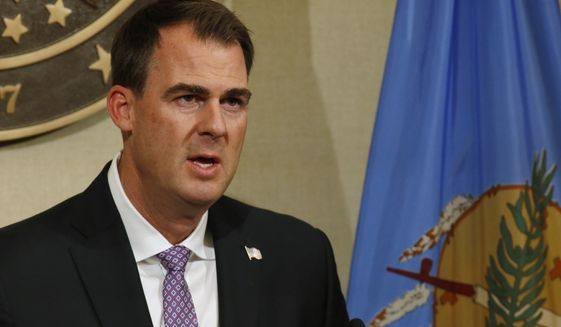 Oklahoma Gov. Kevin Stitt speaks during a news conference Wednesday, May 20, 2020, in Oklahoma City. Stitt said the state is launching an online portal for cities and counties to submit requests for reimbursement from federal funds for their coronavirus-related expenses. (AP Photo/Sue Ogrocki)