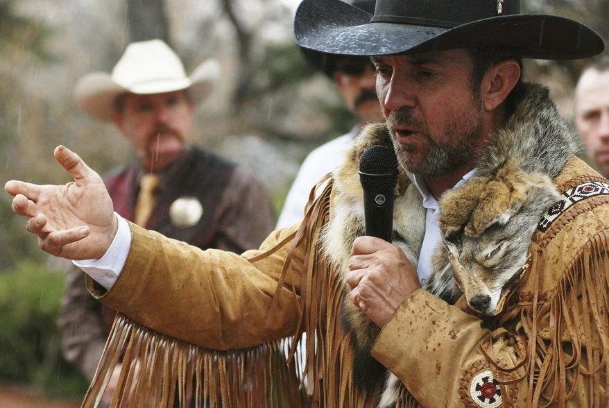 FILE - In this March 12, 2019, file photo, Otero County Commissioner and Cowboys for Trump founder Coy Griffin denounces gun control and pro-abortion rights bills in the New Mexico State Legislature at a protest outside the Statehouse in Santa Fe, N.M. The group said this week seek arbitration in a fight with the New Mexico Secretary of State over fines and required reports. (AP Photo/Morgan Lee, File)
