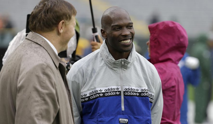 """FILE - In this Sept. 22, 2019, file photo, former NFL football player player Chad Johnson, right, talks with Green Bay Packers president and chief executive officer Mark Murphy before the start of a game between the Denver Broncos and Green Bay Packers in Green Bay, Wis. Chad Johnson left a whooping $1,000 tip for his waiter after dining at a restaurant in Florida that recently reopened amid the coronavirus outbreak. """"Congrats on re-opening, sorry about the pandemic, hope this helps. I LOVE YOU,"""" Johnson wrote Monday, May 18, 2020, on his $37 tab. (AP Photo/Mike Roemer, File)"""