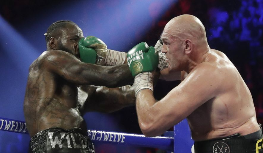 In this Feb. 22, 2020, file photo, Tyson Fury, of England, lands a right to Deontay Wilder, left, during a WBC heavyweight championship boxing match in Las Vegas. Boxing promoter Bob Arum says he plans to stage a card of five fights on June 9 at the MGM Grand. It's the first of a series of fights over the next two months at the Las Vegas hotel. A second fight card will be held two nights later. ESPN will televise both cards to kick off twice weekly shows at the hotel in June and July. The fights are pending approval of the Nevada Athletic Commission. (AP Photo/Isaac Brekken, File)  **FILE**