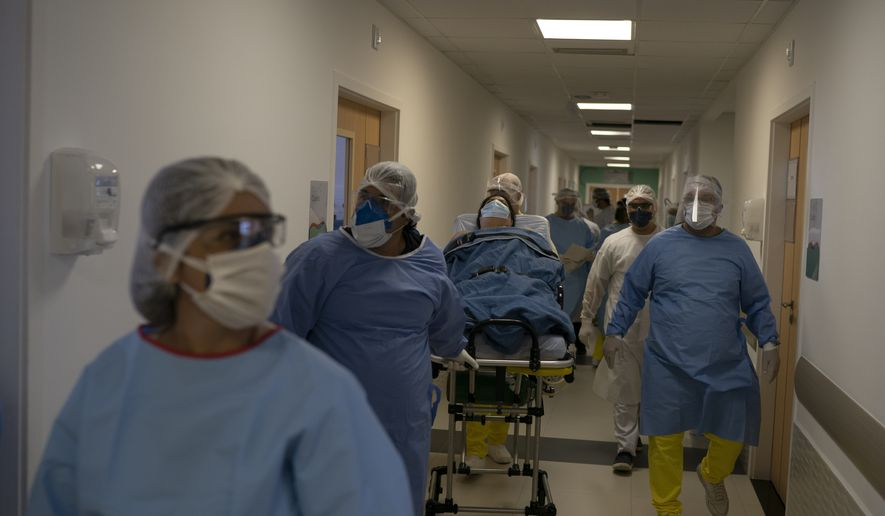 Medical workers move new coronavirus patient Rosane Pacheco to be treated at the Dr. Ernesto Che Guevara hospital in Marica, Brazil, Thursday, May 21, 2020. (AP Photo/Leo Correa)