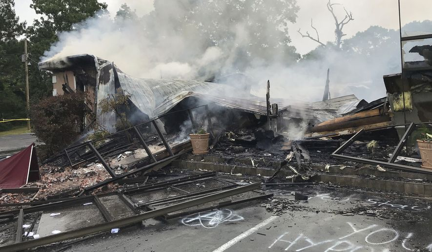 In this photo provided by the Marshall County Sheriff's Office embers smolder on the remains of the First Pentecostal Church in Holly Springs, Miss., Wednesday, May 20, 2020. Mississippi Gov. Tate Reeves on Thursday, May 21, 2020 condemned the church fire that's being investigated as an arson. The church burned about a month after it filed a lawsuit challenging city restrictions on gatherings amid the coronavirus pandemic. (Major Kelly McMillen/Marshall County Sheriff's Office via AP)