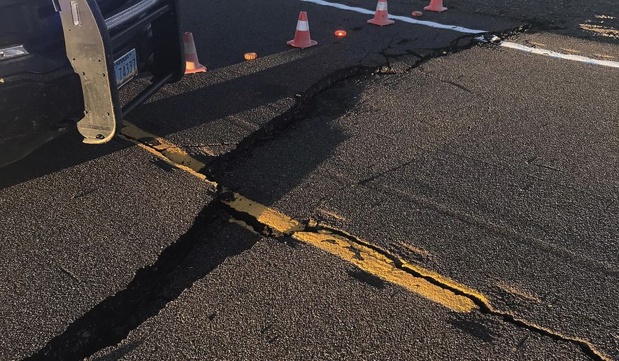 This Friday, May 15, 2020, photo provided by the Nevada Department of Transportation shows earthquake damage that has closed U.S. Highway 95 for repairs after a magnitude 6.5 earthquake near Tonopah, Nev. (Nevada Department of Transportation via AP)