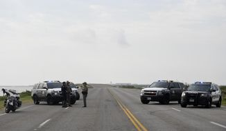 """The entrances to the Naval Air Station-Corpus Christi are closed following an active shooter threat, Thursday, May 21, 2020, in Corpus Christi, Texas. Naval Air Station-Corpus Christi says the shooter was """"neutralized"""" and the facility is on lockdown.  (Annie Rice/Corpus Christi Caller-Times via AP)"""
