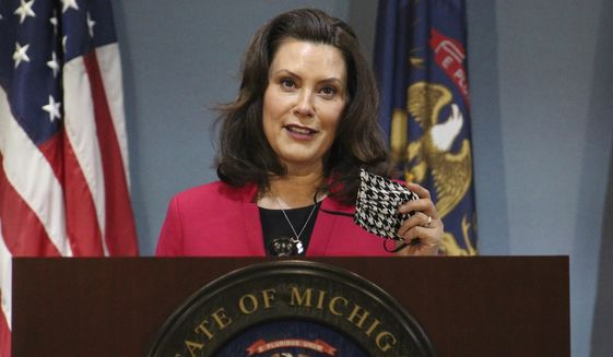 In this Thursday, May 21, 2020 photo provided by the Michigan Office of the Governor, Michigan Gov. Gretchen Whitmer speeks during a news conference in Lansing, Mich. Whitmer is relaxing coronavirus restrictions to lift a ban on nonessential medical and dental procedures, reopen retail shops and let residents gather in groups of 10 or less. The small social gatherings can start immediately. Retails stores and auto dealerships can reopen by appointment only starting Tuesday. Medical, dental and veterinary offices can resume nonessential procedures beginning May 29. (Michigan Office of the Governor via AP, Pool)