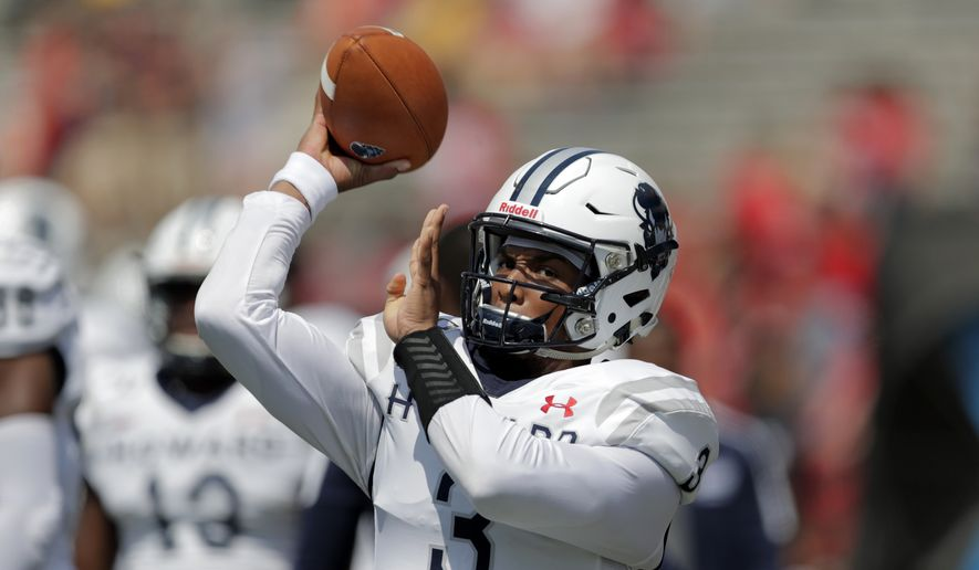 Howard quarterback Caylin Newton warms up prior to an NCAA college football game against Maryland, Saturday, Aug. 31, 2019, in College Park, Md. (AP Photo/Julio Cortez)  **FILE**
