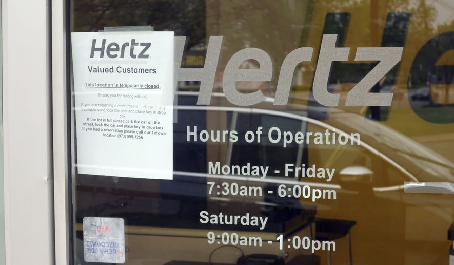 A Hertz Car Rental is closed during he coronavirus pandemic on Wednesday, May 6, 2020 in Paramus, New Jersey. (AP Photo/Ted Shaffrey)