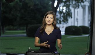 This July 25, 2018, file photo shows CNN White House correspondent Kaitlan Collins during a live shot in front of the White House in Washington. Reporters Collins, Yamiche Alcindor and Weijia Jiang have faced hostility from President Donald Trump at news conferences with stoicism. Their experiences illustrate the challenge of working at a White House with near-daily accessibility to a president who considers the press an enemy. (AP Photo/Alex Brandon, File)