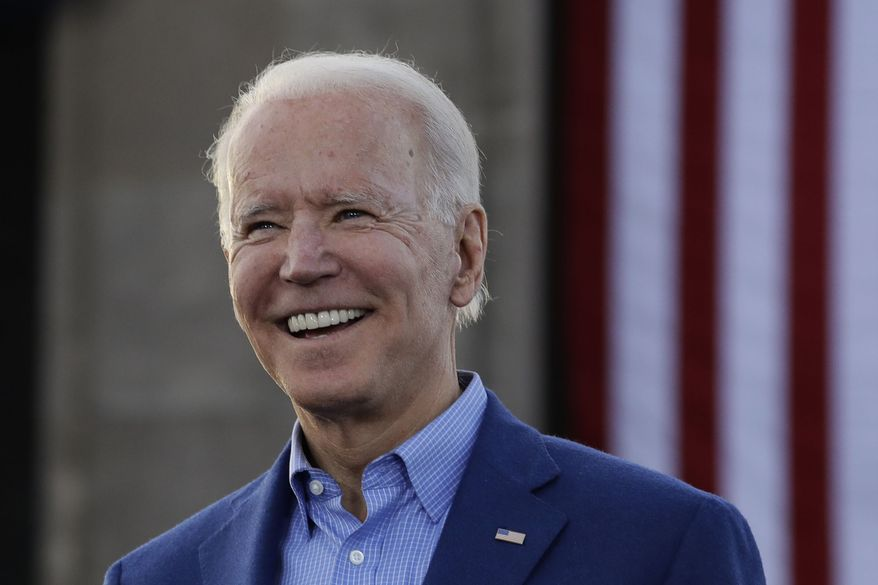 In this March 7, 2020, file photo, Democratic presidential candidate former Vice President Joe Biden acknowledges the crowd during a campaign rally in Kansas City, Mo. (AP Photo/Charlie Riedel, File)