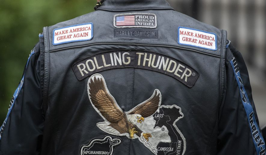 """The back of Rolling Thunder jacket is seen before President Donald Trump speaks during a """"Rolling to Remember Ceremony,"""" to honor the nation's veterans and POW/MIA, from the Blue Room Balcony of the White House, Friday, May 22, 2020, in Washington. (AP Photo/Alex Brandon) ** FILE **"""